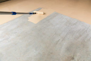 Epoxy Floor Paint being rolled onto a garage floor