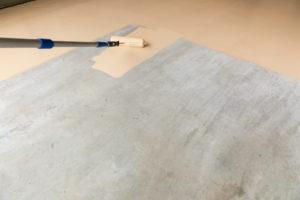 Epoxy Floor Paint being rolled onto a garage floor
